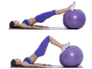 Step by step instructions: Start position as shown by lying on floor, bottom of feet supported on ball. (A) Lift your hips up off the floor and contract your butt and hamstrings. (B)